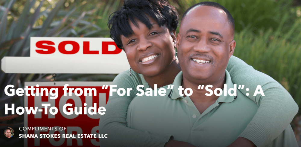 African-American Couple in Front of Sold Sign